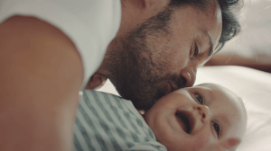 family building father kissing child